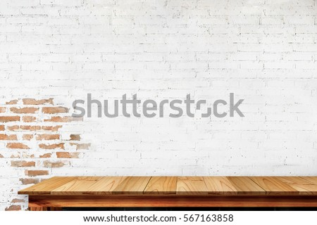 Empty top of natural wooden table and retro white brick wall background. For product display #567163858