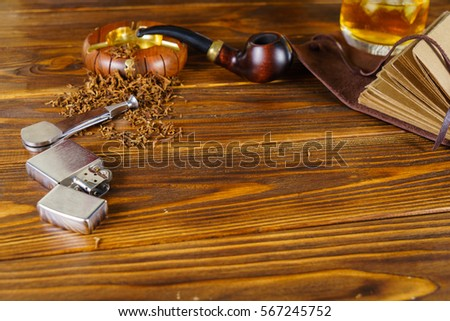 Background on the topic of men's rest. Pipe, whiskey and notebook #567245752
