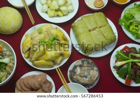 Amazing of Vietnamese food for Tet holiday in spring, it is traditional food on lunar new year: Banh chung, Boiled chicken, pickled onions, spring rolls ... #567286453