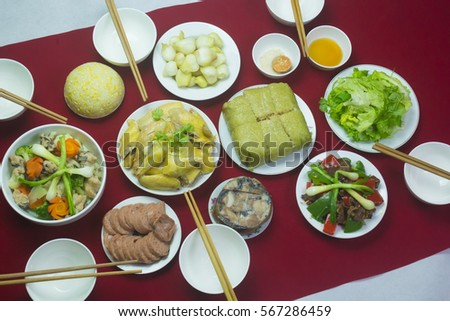 Amazing of Vietnamese food for Tet holiday in spring, it is traditional food on lunar new year: Banh chung, Boiled chicken, pickled onions, spring rolls ... #567286459