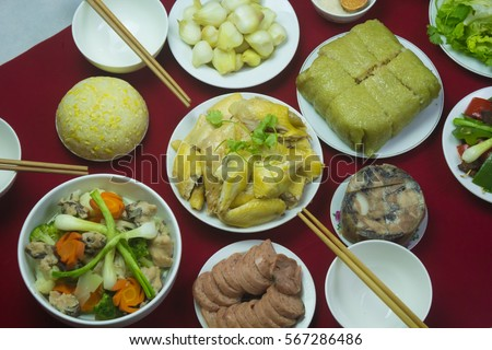 Amazing of Vietnamese food for Tet holiday in spring, it is traditional food on lunar new year: Banh chung, Boiled chicken, pickled onions, spring rolls ... #567286486