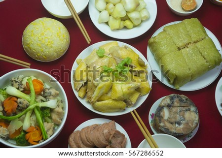 Amazing of Vietnamese food for Tet holiday in spring, it is traditional food on lunar new year: Banh chung, Boiled chicken, pickled onions, spring rolls ... #567286552