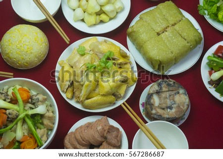 Amazing of Vietnamese food for Tet holiday in spring, it is traditional food on lunar new year: Banh chung, Boiled chicken, pickled onions, spring rolls ... #567286687