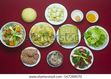 Amazing of Vietnamese food for Tet holiday in spring, it is traditional food on lunar new year: Banh chung, Boiled chicken, pickled onions, spring rolls ... #567288070