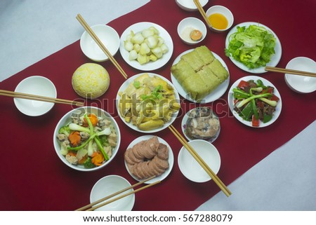 Amazing of Vietnamese food for Tet holiday in spring, it is traditional food on lunar new year: Banh chung, Boiled chicken, pickled onions, spring rolls ... #567288079