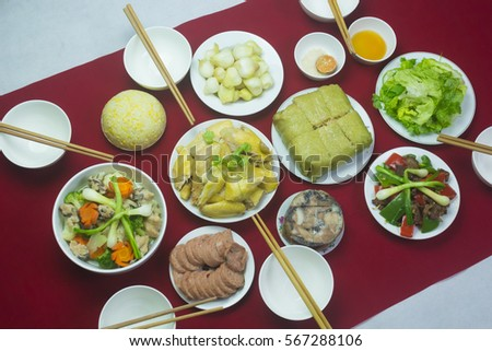 Amazing of Vietnamese food for Tet holiday in spring, it is traditional food on lunar new year: Banh chung, Boiled chicken, pickled onions, spring rolls ... #567288106