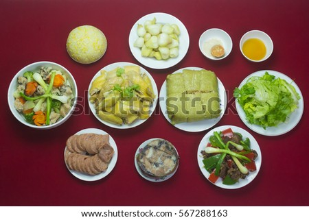 Amazing of Vietnamese food for Tet holiday in spring, it is traditional food on lunar new year: Banh chung, Boiled chicken, pickled onions, spring rolls ... #567288163