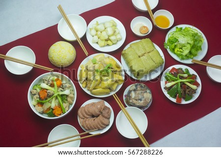 Amazing of Vietnamese food for Tet holiday in spring, it is traditional food on lunar new year: Banh chung, Boiled chicken, pickled onions, spring rolls ... #567288226