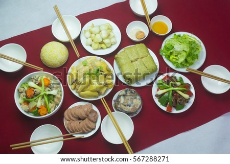 Amazing of Vietnamese food for Tet holiday in spring, it is traditional food on lunar new year: Banh chung, Boiled chicken, pickled onions, spring rolls ... #567288271