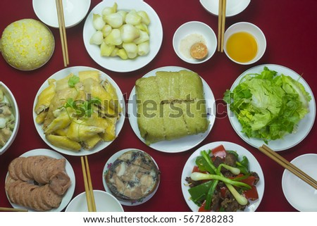 Amazing of Vietnamese food for Tet holiday in spring, it is traditional food on lunar new year: Banh chung, Boiled chicken, pickled onions, spring rolls ... #567288283