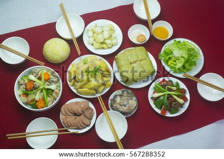 Amazing of Vietnamese food for Tet holiday in spring, it is traditional food on lunar new year: Banh chung, Boiled chicken, pickled onions, spring rolls ... #567288352