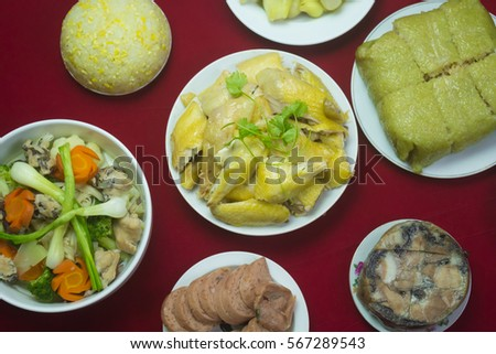 Amazing of Vietnamese food for Tet holiday in spring, it is traditional food on lunar new year: Banh chung, Boiled chicken, pickled onions, spring rolls ... #567289543