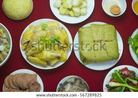 Amazing of Vietnamese food for Tet holiday in spring, it is traditional food on lunar new year: Banh chung, Boiled chicken, pickled onions, spring rolls ... #567289825