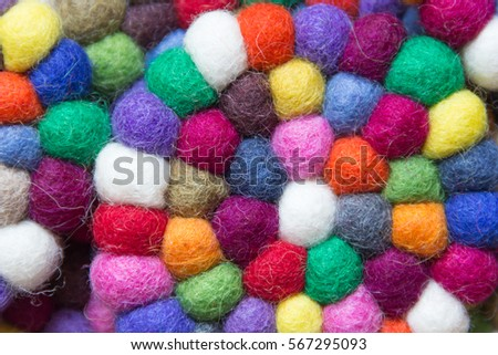 colorful balls of wool tied together for background #567295093
