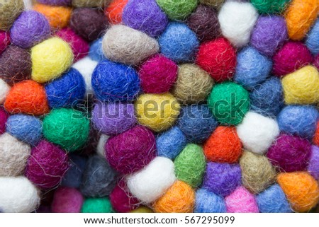 colorful balls of wool tied together for background #567295099