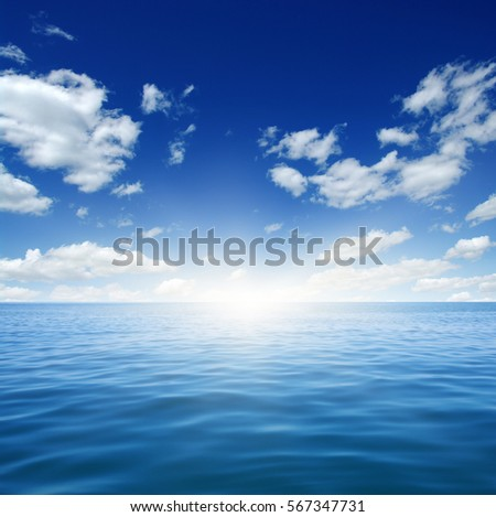 Blue sea and sun on sky #567347731