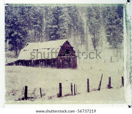 Old cow barn in snow storm. Colorado Rocky Mountains, instant photo image transfer on a cold press watercolor paper (rough texture).