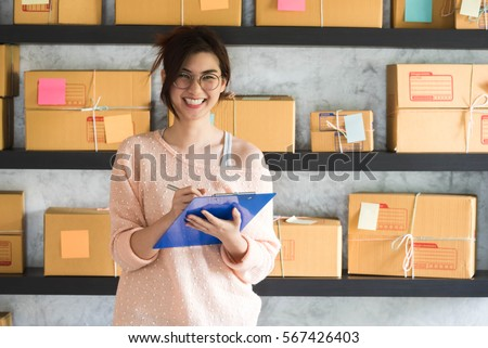 Young entrepreneur, teenager business owner work at home, alpha generation life style. smile and laugh happily Royalty-Free Stock Photo #567426403