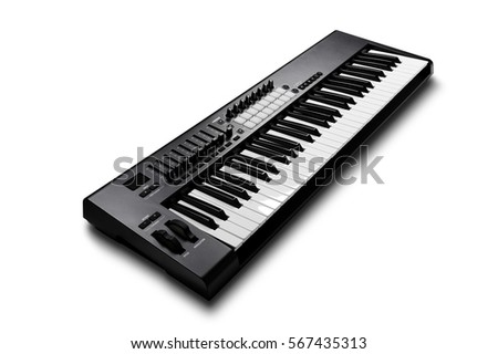 Electronic synthesizer (piano keyboard) isolated on white background with clipping path Royalty-Free Stock Photo #567435313