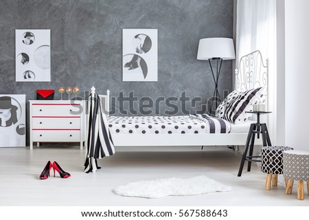 Grey and white decor of stylish woman's bedroom #567588643