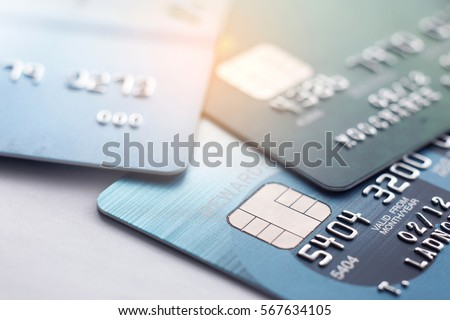 Credit card close up shot with selective focus for background. #567634105
