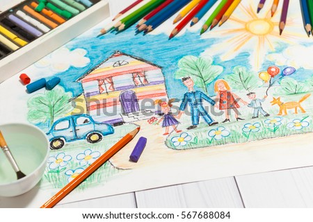 Hand drawn Bright Childrens Sketch With Happy Family, House, Dog, Car on the Lawn with Flowers with lying pencils and pastel - concept of children creativity, close up perspective view.