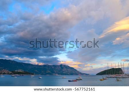 Panoramic View of Budva Coastline, Famous Island of Sveti Nikola and the Dock with Lot of Boats in Budva. Montenegro, Balkans, Adriatic sea, Europe. #567752161