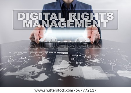 Businessman using tablet pc and selecting digital rights management.