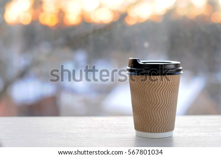 Cup with coffee on background of dawn. #567801034