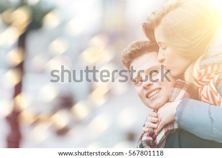 Young beautiful couple having fun in the winter on the street. Couple in love on Valentine's Day #567801118