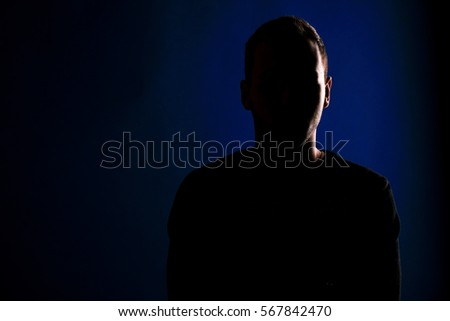 male silhouette on a blue background #567842470