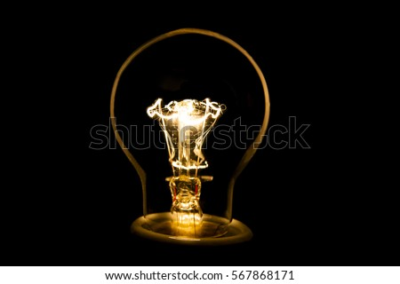 A lit light bulb isolated on black   #567868171