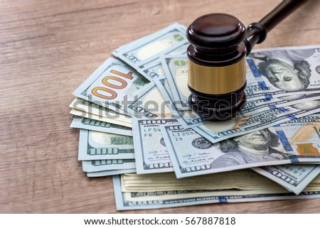 wooden gavel with usa dollar on desk. close up. macro Royalty-Free Stock Photo #567887818