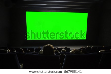 cinema auditorium with heads, chairs and green projection screen. Ready for adding your own picture.