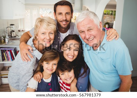 Portrait of smiling family with grandparents at home #567981379
