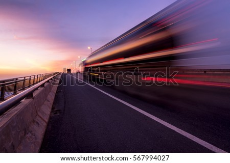 Blurred motion truck on the road with Sunset