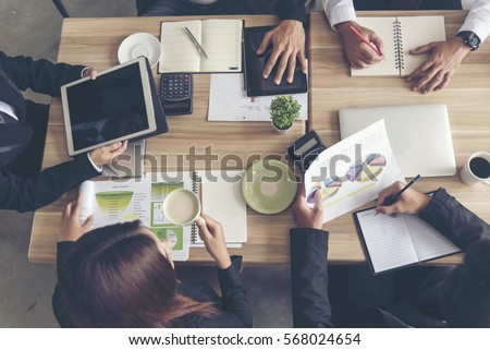 Teamwork Concept. Collaboration Team Meeting Communication with Business Teamwork Working Together in Conference Room. Top view of Diversity Partner Business Meeting Trust in Businessman and Team. Royalty-Free Stock Photo #568024654