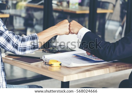 Partner Business Trust Teamwork Partnership. Industry contractor fist bump dealing mission business. Mission team meeting group of People Fist bump Hands together. Business industry trust teamwork Royalty-Free Stock Photo #568024666