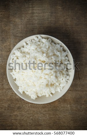 Jasmine rice isolated on wooden table #568077400