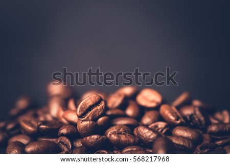 Brown roasted coffee beans, seed on dark background. Espresso dark, aroma, black caffeine drink. Closeup isolated energy mocha, cappuccino ingredient. #568217968