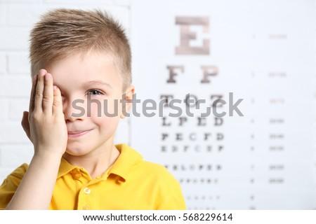 Little boy having eye test at ophthalmologist office #568229614
