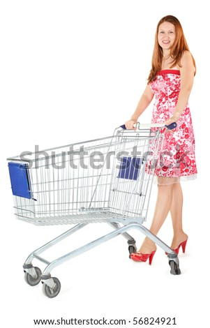 joyful woman wearing dress is standing with shopping basket. isolated. #56824921
