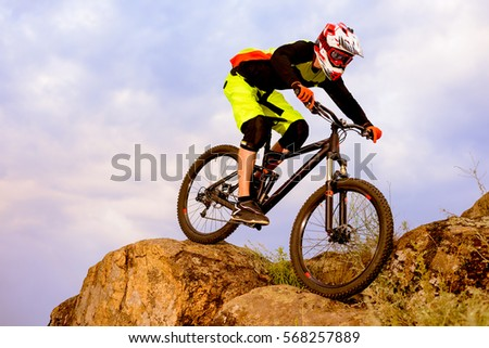 Professional Cyclist Riding the Bike on the Top of the Rock. Extreme Sport Concept. Free Space for Text. #568257889