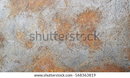 Rusted on surface of the old iron, Deterioration of the steel, Decay and grunge Texture background Royalty-Free Stock Photo #568363819