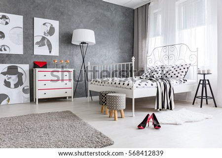 Stylish grey and white bedroom designed for woman #568412839