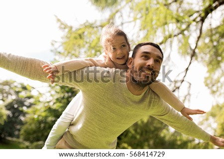 family, parenthood, fatherhood and people concept - happy man and little girl in having fun in summer park #568414729