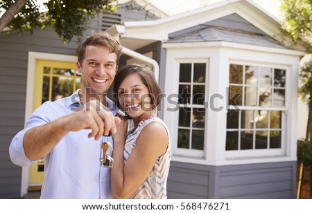Couple With Keys Standing Outside New Home #568476271