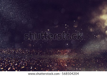 glitter vintage lights background. gold and black. de-focused Royalty-Free Stock Photo #568504204