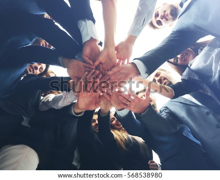 Large successfull business team showing unity with their hands t #568538980