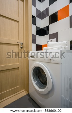 towels on the washing machine in the bathroom #568660102